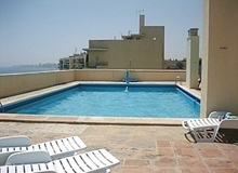 Olimpo 2nd floor Apartment Beachfront with Communal Swimming Pool